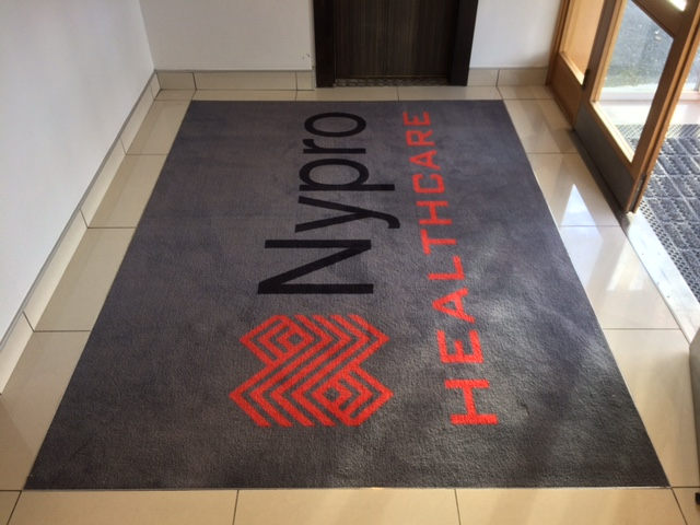 Nypro Healthcare Logo Mat in matwell with frame