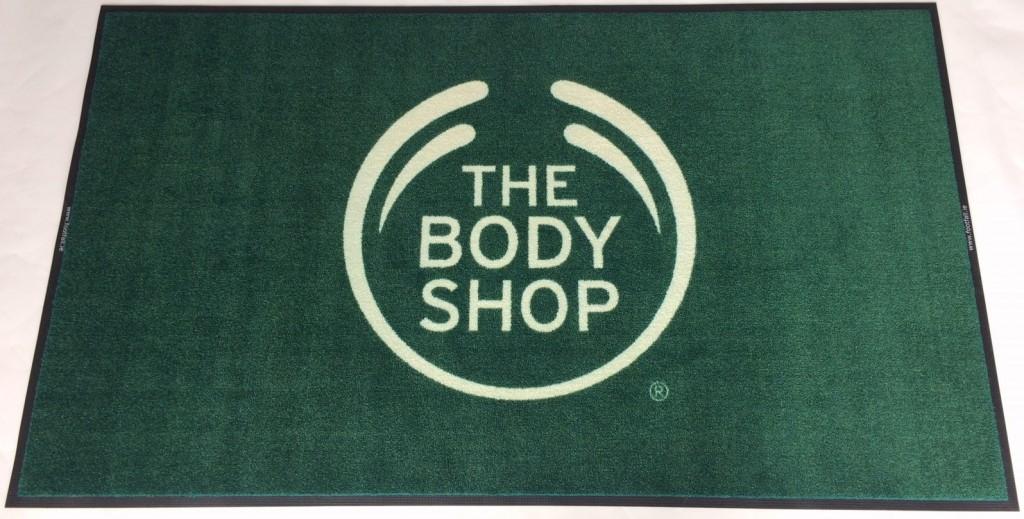 The Body Shop logo mat